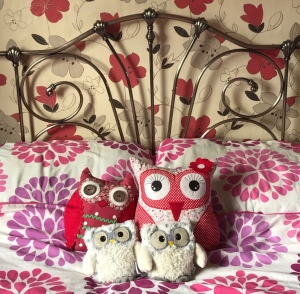 Owl cushions on a bed